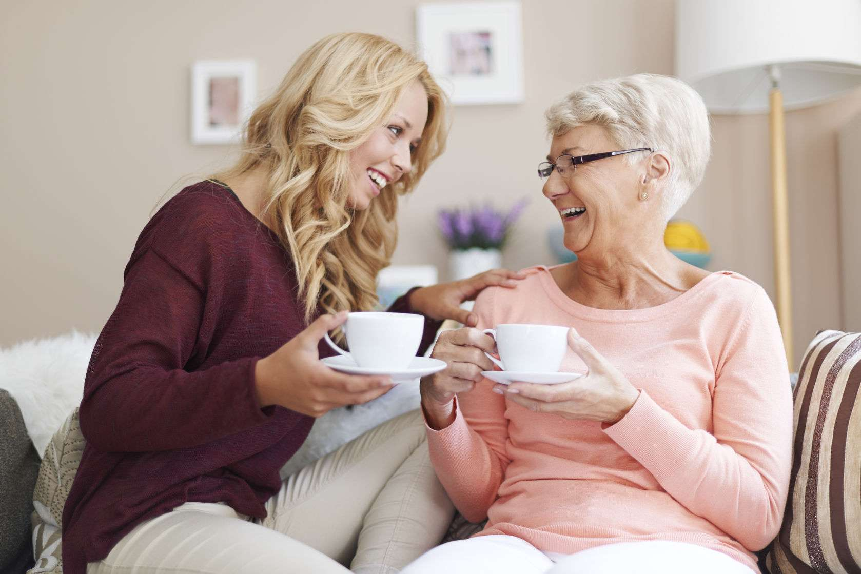 Client and caregiver drinking coffee together